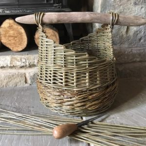 Handwoven almond leaved willow basket with driftwood handle.